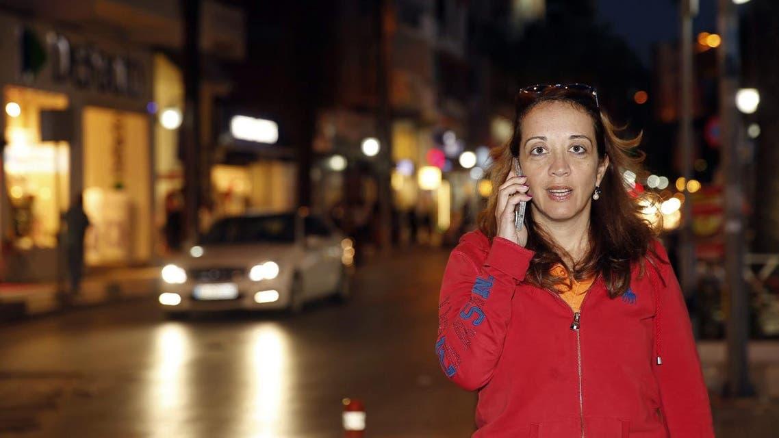 Dutch-Turkish journalist Ebru Umar talks on her mobile phone in Kusadasi, Turkey, Monday, April 25, 2016. AP