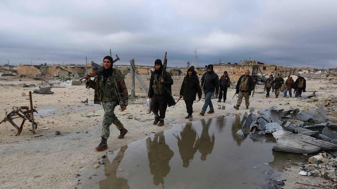 Rebel fighters walk on the al-Breij frontline, after what they said was an advance by them in the Manasher al-Hajr area where the forces of Syria's President Bashar al-Assad were stationed, in Aleppo January 7, 2015. REUTERS