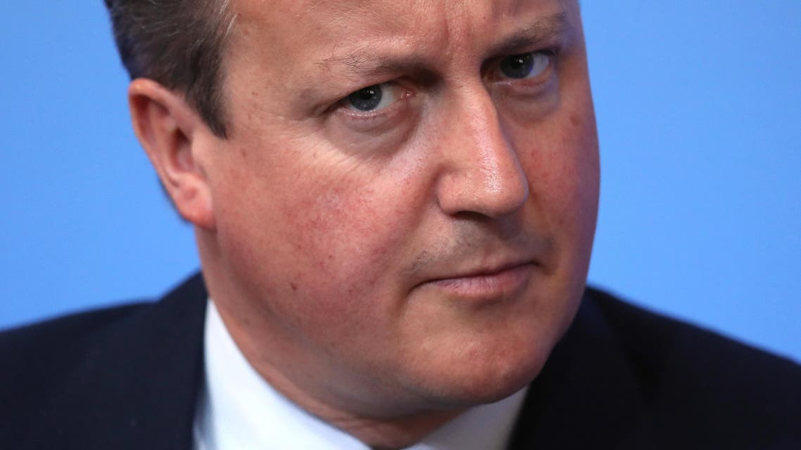 """British Prime Minister David Cameron listens during the international anti-corruption summit on Thursday May 12, 2016 in London. British Prime Minister David Cameron on Thursday called corruption a """"cancer"""" at the heart of the world's problems, while U.S. Secretary of State John Kerry said the corruption """"pandemic"""" was as great a threat as extremism. (Dan Kitwood/Pool via AP)"""