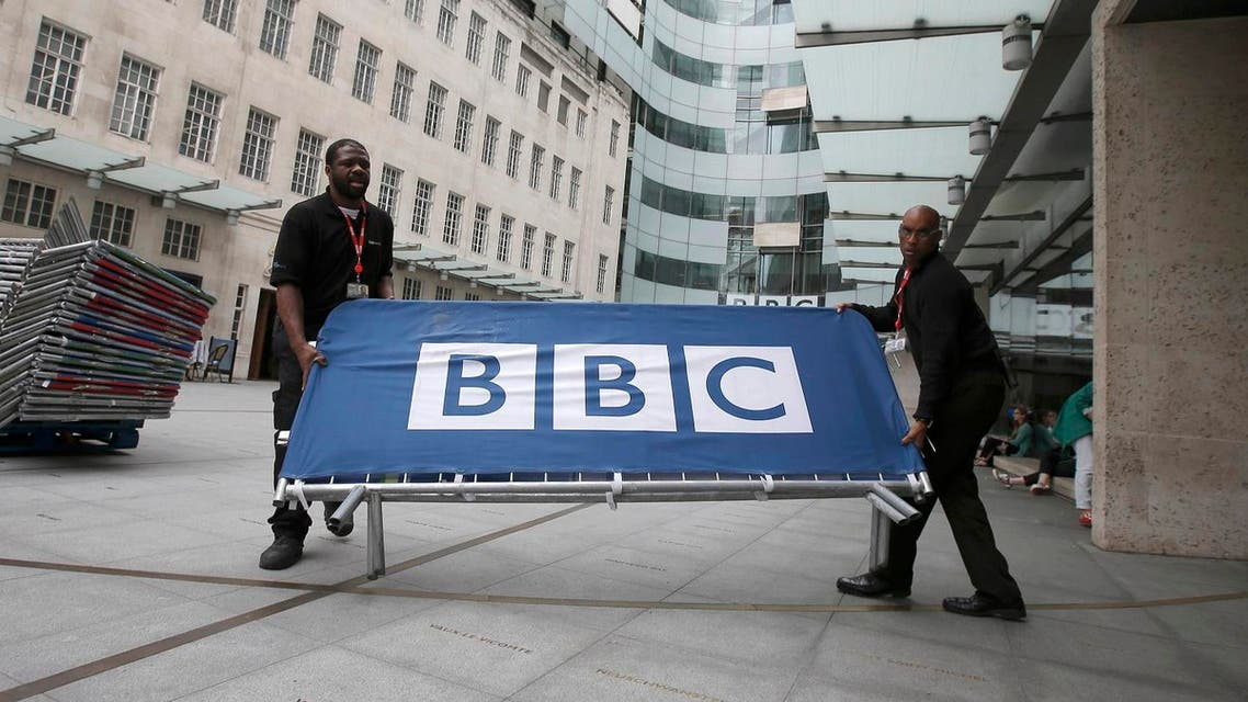 BBC workers place barriers near to the main entrance of the BBC headquarters and studios in Portland Place, London, Britain, July 16, 2015. REUTERS/Peter Nicholls/File Photo