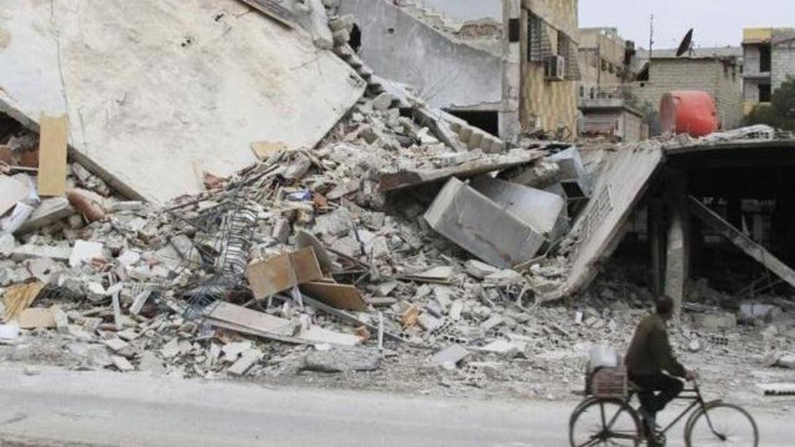 A man rides a bicycle past a damaged building in Daraya, near Damascus February 2, 2014. Reuters/Omar Abu Bakr