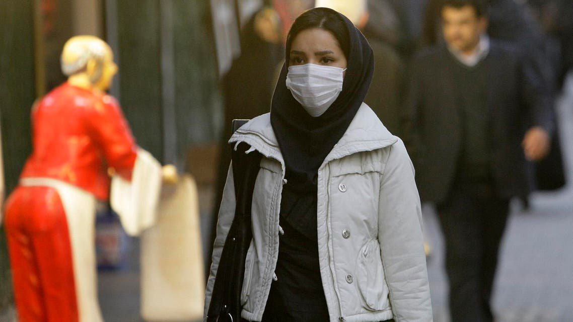 An Iranian woman wears a mask to help guard against dangerous levels of air pollution as she walks in the center of the smog-filled capital, Tehran, Iran. (File photo: AP)