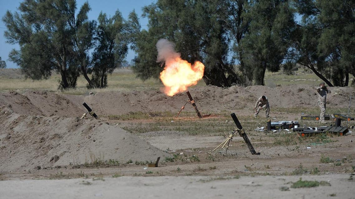 Iraqi soldiers fire a mortar toward Islamic State militants on the outskirts of Fallujah. (Reuters)