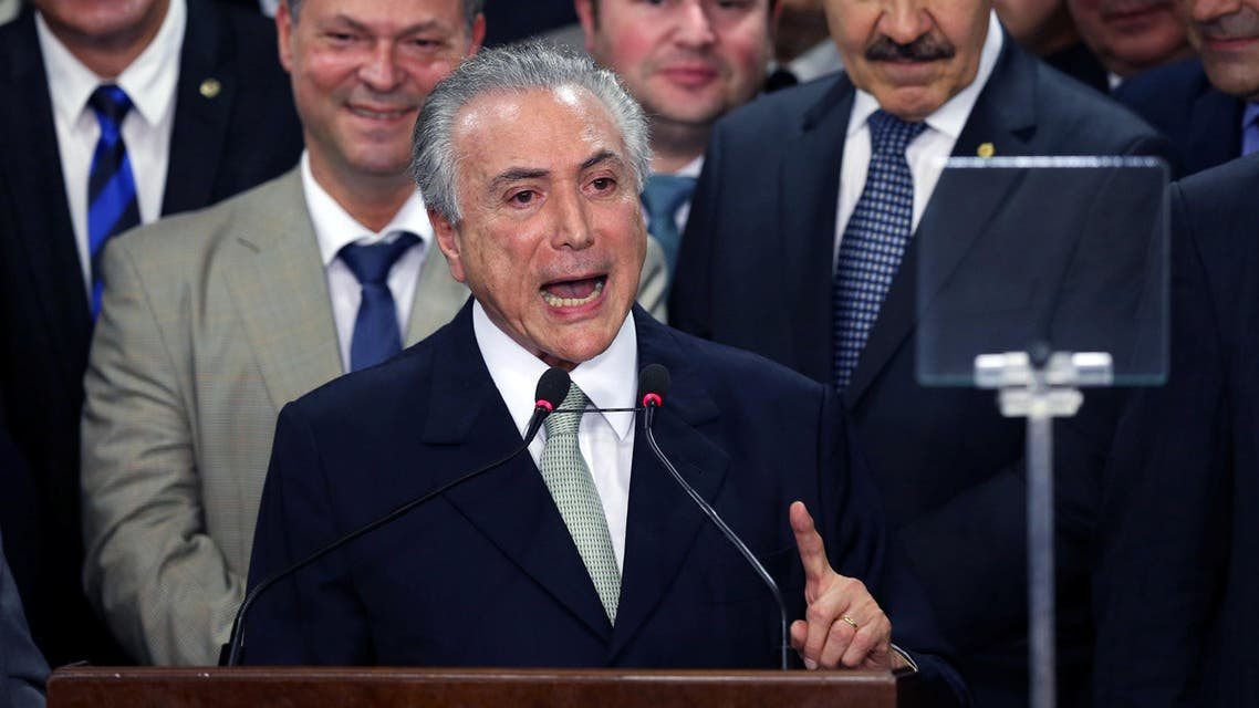 Brazil's interim President Michel Temer addresses the audience during his first public remarks after the Brazilian Senate voted to impeach President Dilma Rousseff at the Planalto Palace in Brasilia, Brazil, May 12, 2016.  reuters