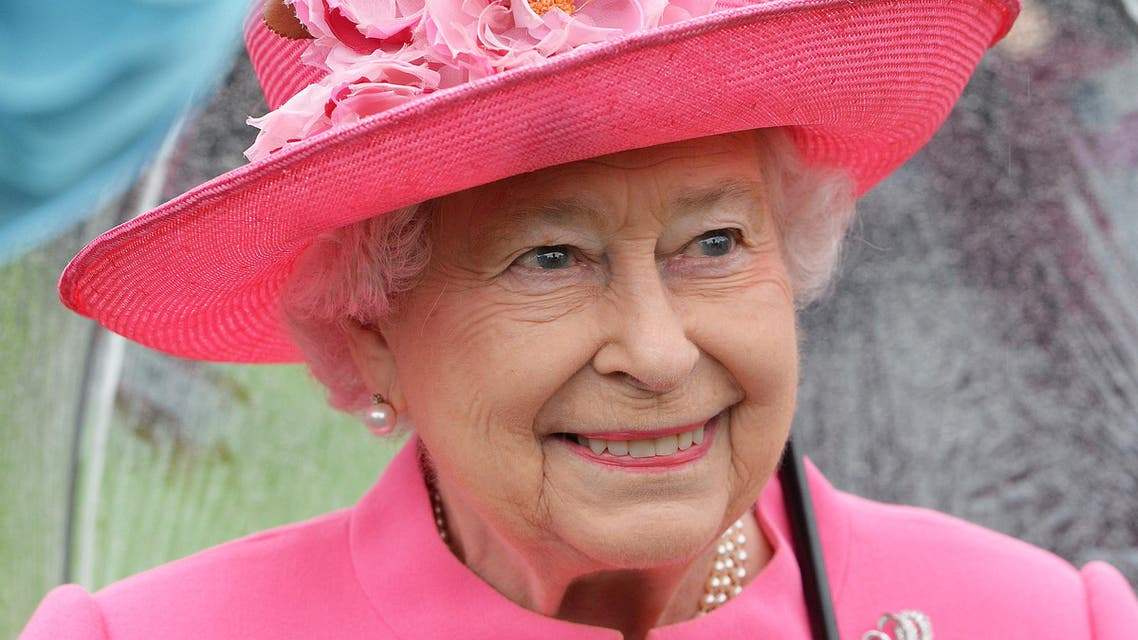 Britain's Queen Elizabeth II speaks to guests in the garden of Buckingham Palace in London as up to 8,000 guests attend the first royal garden party of the year on May 10, 2016. (AFP)