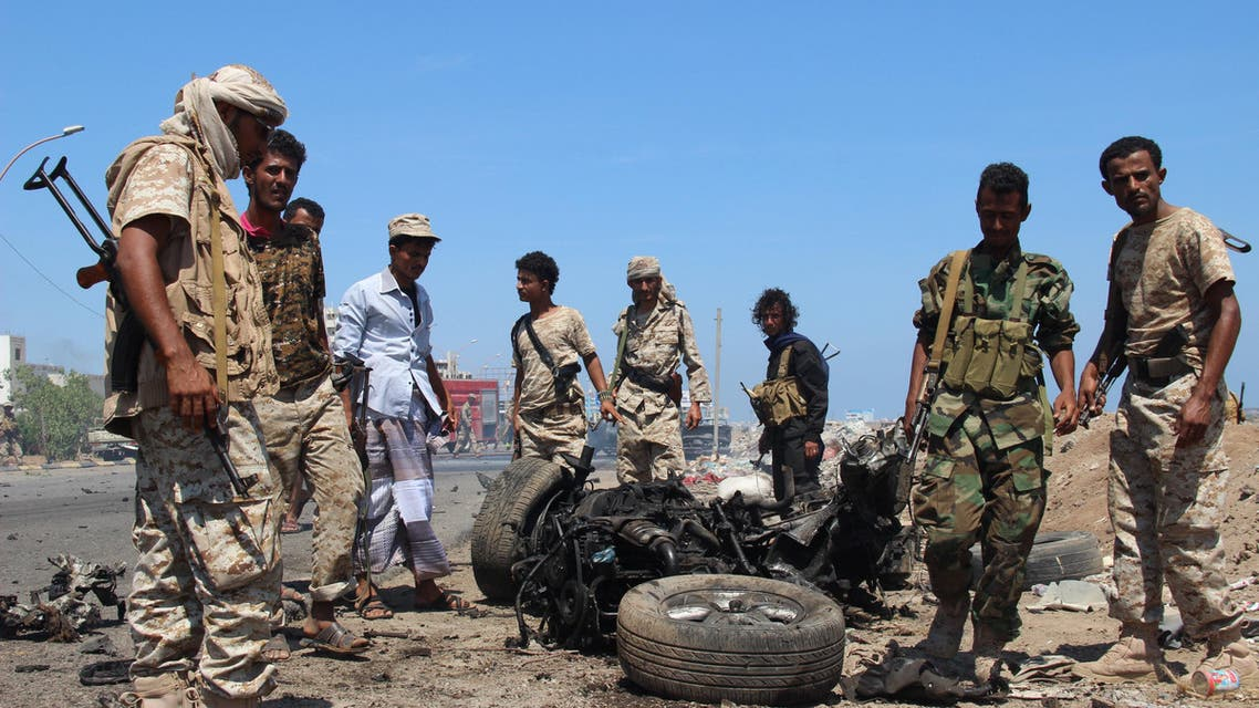 Soldiers gather at the site of a car bomb attack in a central square in the port city of Aden, Yemen, May 1, 2016, that targeted the city's security chief for the second time in a week.  reuters