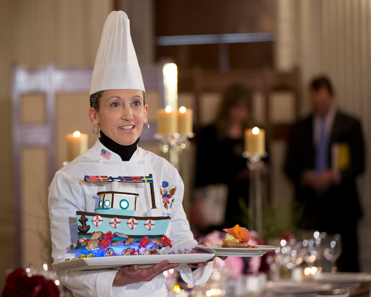 White House Executive Pastry Chef Susan Morrison shows the dessert during a press preview in the State Dining Room at the White House in Washington, Thursday, May 12, 2016, for the state dinner in honor of the official visit of Nordic leaders. (AP