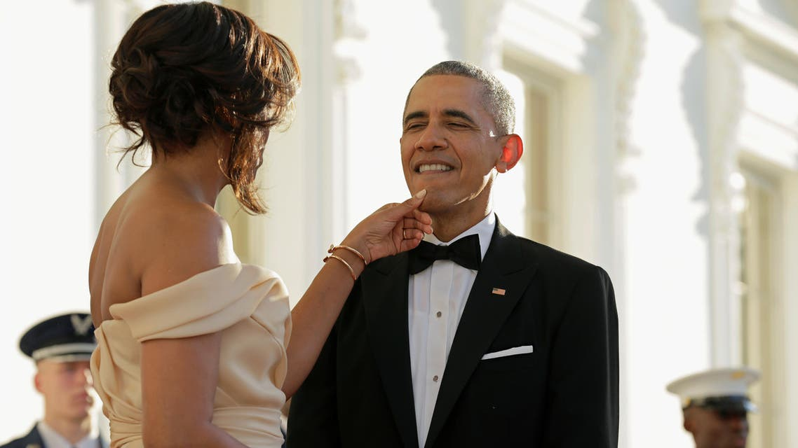 U.S. First Lady Michelle Obama touches the chin of U.S. President Barack Obama before the arrival of Nordic leaders at the White House in Washington, U.S., May 13, 2016
