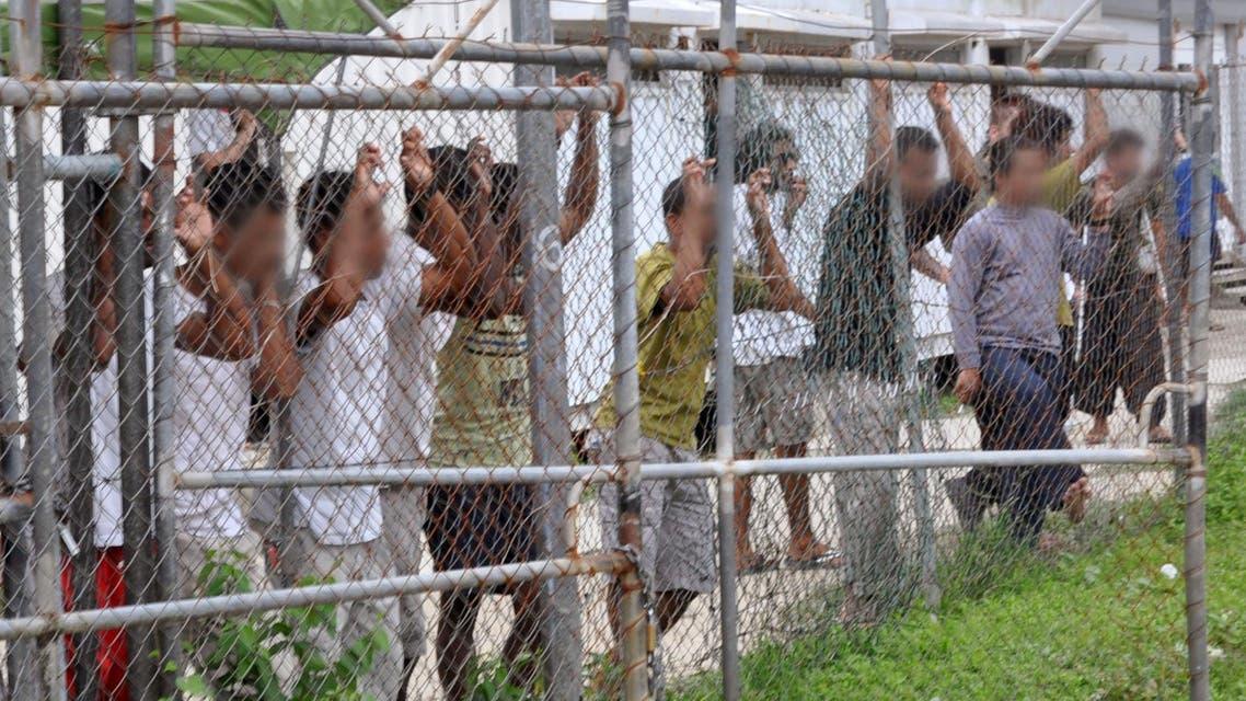مهاجرون حاولوا الوصول الى استراليا وانتهى بهم المطاف في مخيم في بابوا غينيا الجديدة لجوء لاجئين لاجئون هجرة