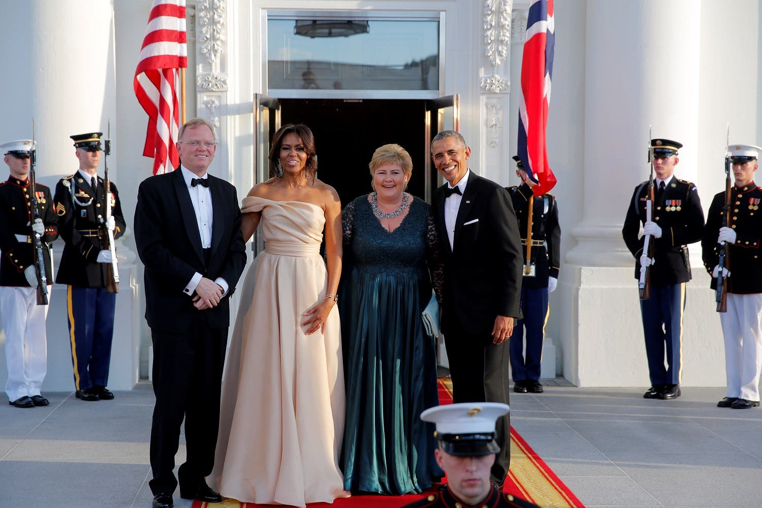 U.S. President Barack Obama and First Lady Michelle Obama welcome Erna Solberg (2nd R) Prime Minister of Norway and Mr. Sindre Finnes (L) at a state dinner in the White House during the U.S.-Nordic Leaders Summit in Washington, U.S. May 13, 2016. REUTERS