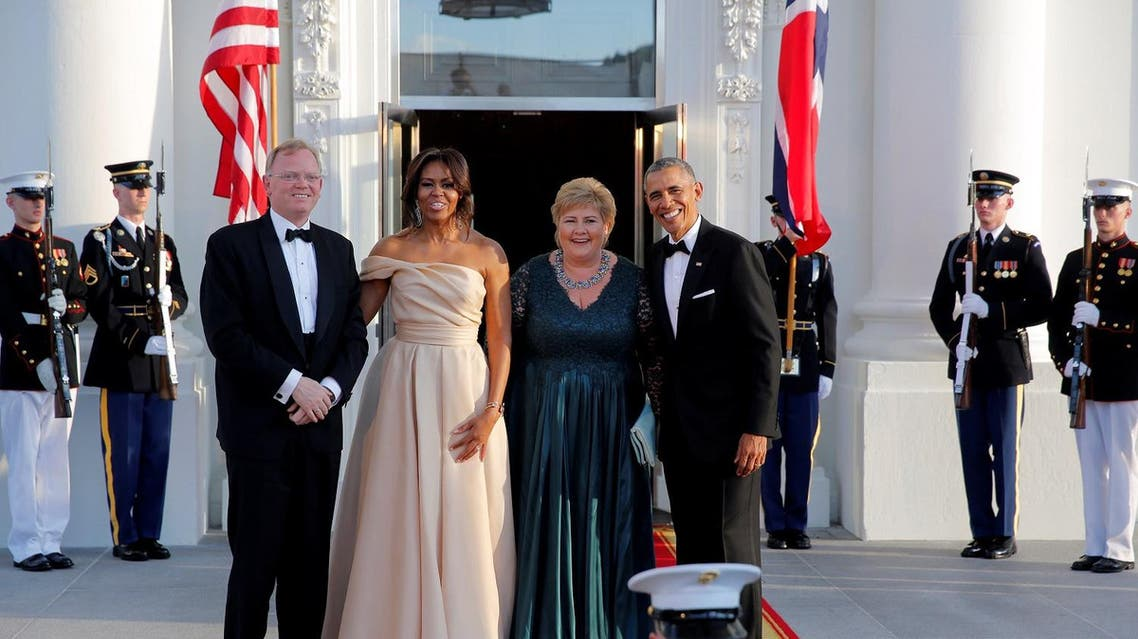 US President Barack Obama and First Lady Michelle Obama welcome Erna Solberg (2nd R) PM of Norway and Mr. Sindre Finnes (L) during the US-Nordic Leaders Summit in Washington. (Reuters)
