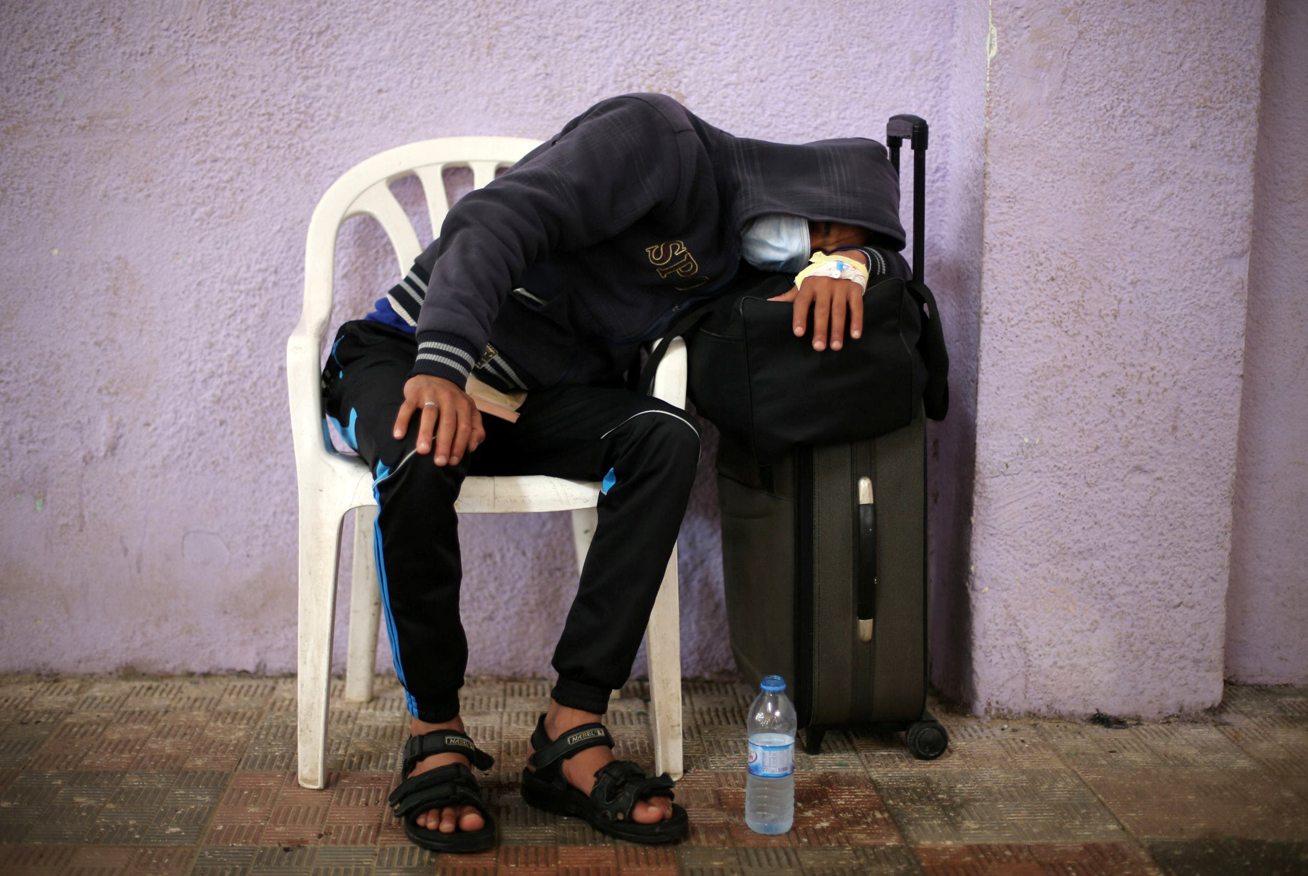 Palestinians wait for relatives to return to Gaza from Egypt