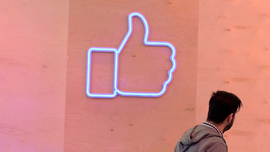 """A man passes a light installation during a press preview of the """"Facebook Innovation Hub"""" in Berlin on February 24, 2016. (AFP)"""