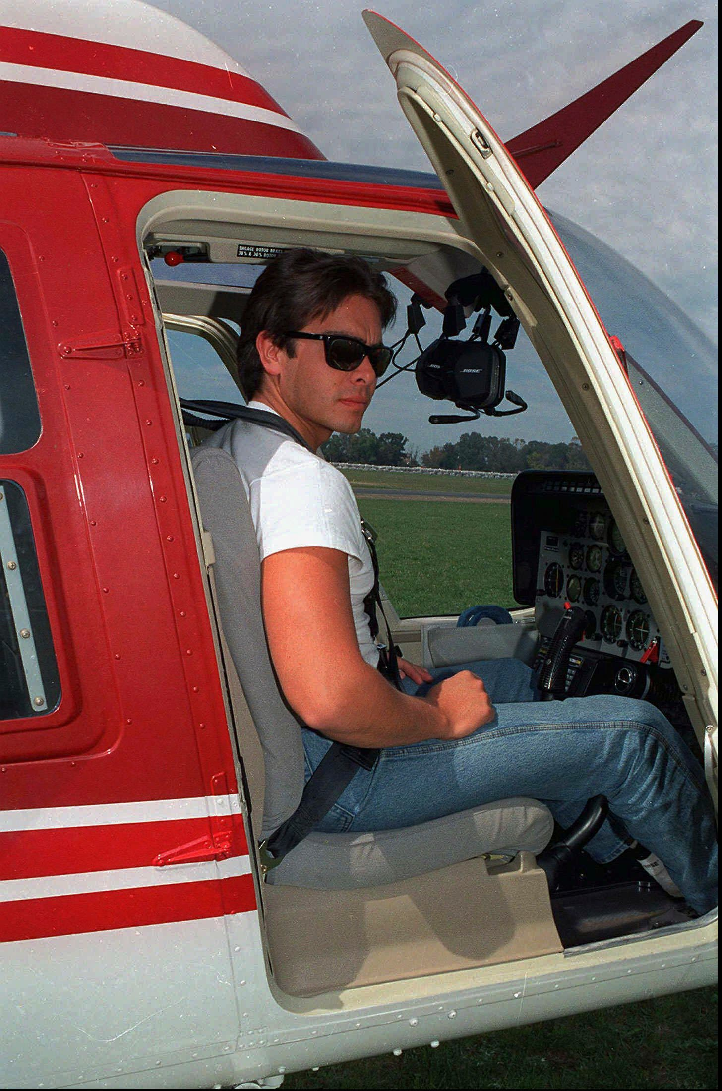 In this Jan. 1995 file photo, Carlos Facundo Menem, the son of Argentina's former President Carlos Menem, sits in a helicopter in an unknown location in Argentina. (AP)