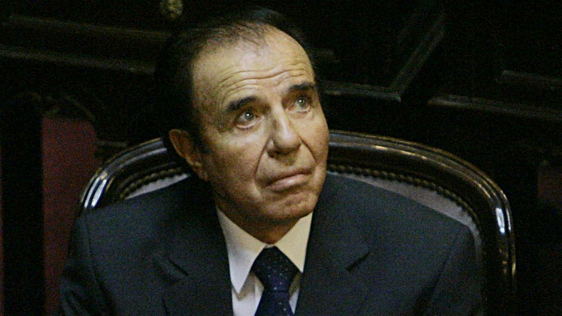 In this Nov. 29, 2005 file photo, Argentina's former President Carlos Menem attends his swearing-in ceremony as senator for La Rioja province at the National Congress in Buenos Aires, Argentina.