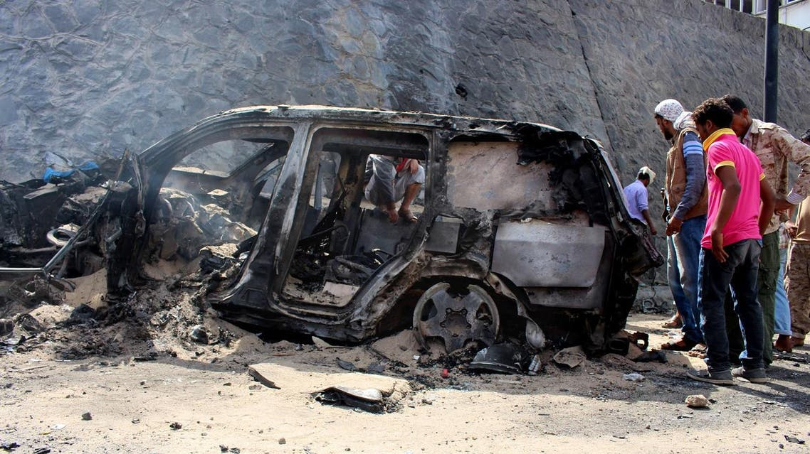 Yemenis inspect the scene of a car bomb attack that killed a Yemeni senior official in the southern port city of Aden, Yemen, Sunday, Dec. 6, 2015. A huge explosion killed the governor of Yemen's southern Aden province and six of his bodyguards on Sunday, security officials said, in an attack that was later claimed by a local Islamic State affiliate. (AP)