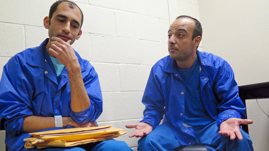 In this Thursday, Dec. 10, 2015 photo, Mounis Hammouda, left, and Hisham Shaban sit in a small room at an immigration detention center in Eloy, Ariz.