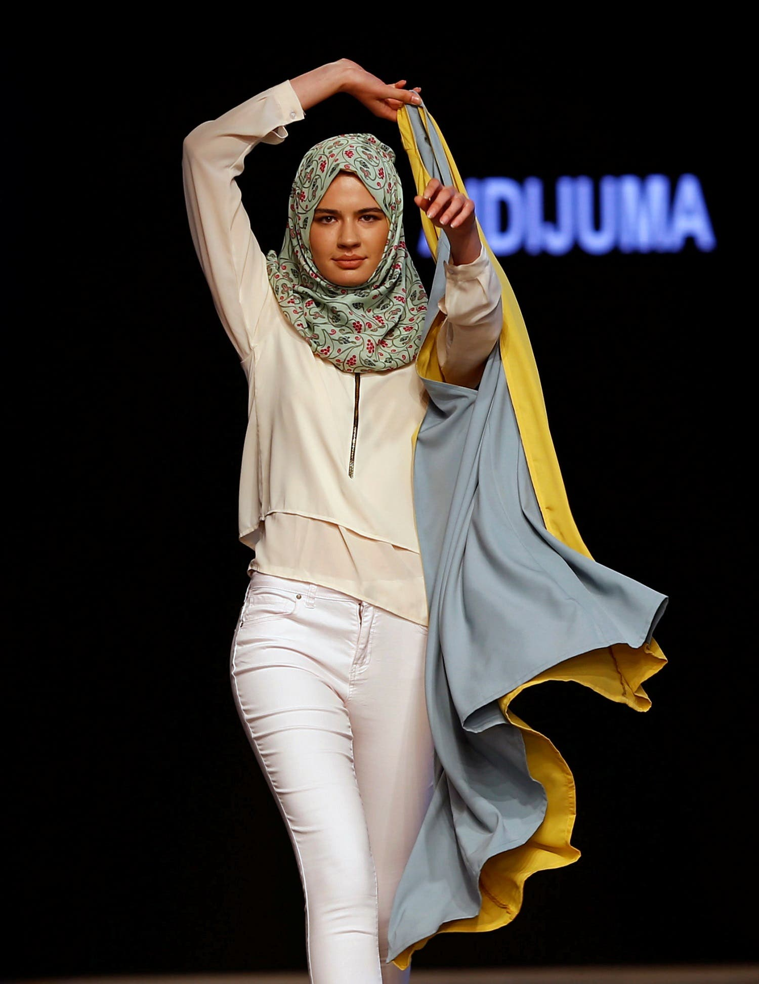 A model presents a creation by Malaysian designer Aidijuma during Istanbul Modest Fashion Week at the historical Haydarpasa train station in Istanbul, Turkey May 13, 2016. REUTERS