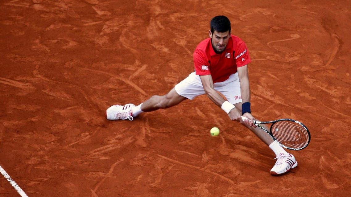 Novak Djokovic of Serbia v Andy Murray of Britain - Madrid, Spain - 8/5/16 Djokovic returns the ball. REUTERS