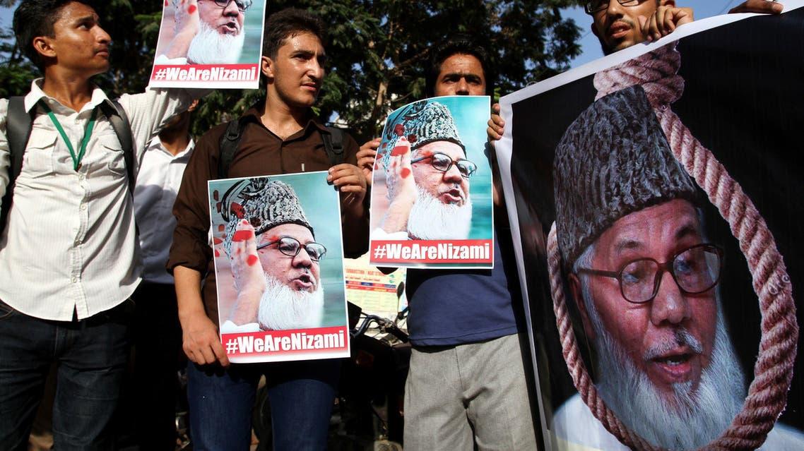 Supporters of Pakistani religious party Jamaat-e-Islami condemn the execution of the party's chief Motiur Motiur Rahman Nizami, in Bangladesh, in Karachi, Pakistan, Wednesday, May 11, 2016. (AP)