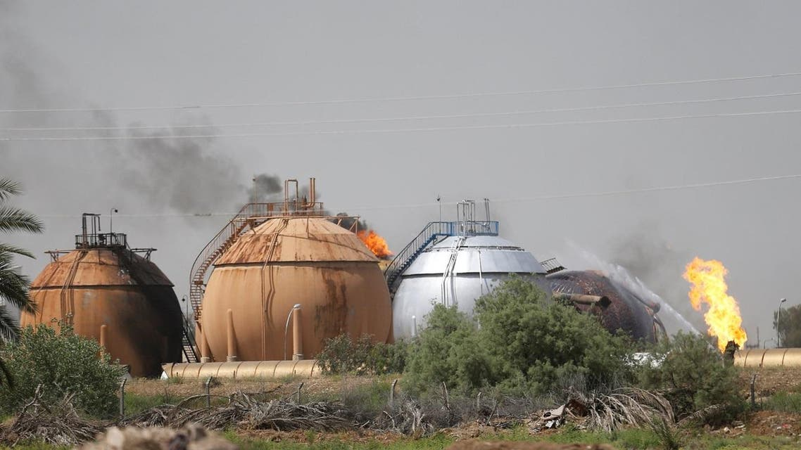 Smoke rises from gas storage tanks after a bomb attack against a state-run cooking gas factory in Taji at Baghdad's northern outskirts, Iraq May 15, 2016. REUTERS