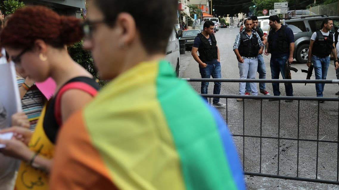 Plainclothed Lebanese policemen, right, hold their weapons as supporters of the LGBT (Lesbian, Gay, Bisexual, and Transgender) community stage a sit-in to protest the ongoing criminalization of homosexuality and arbitrary arrests, in front of Hobeich Police Station, where protesters say four men are being held for homosexuality, in Beirut, Lebanon, Sunday, May 15, 2016. (AP)