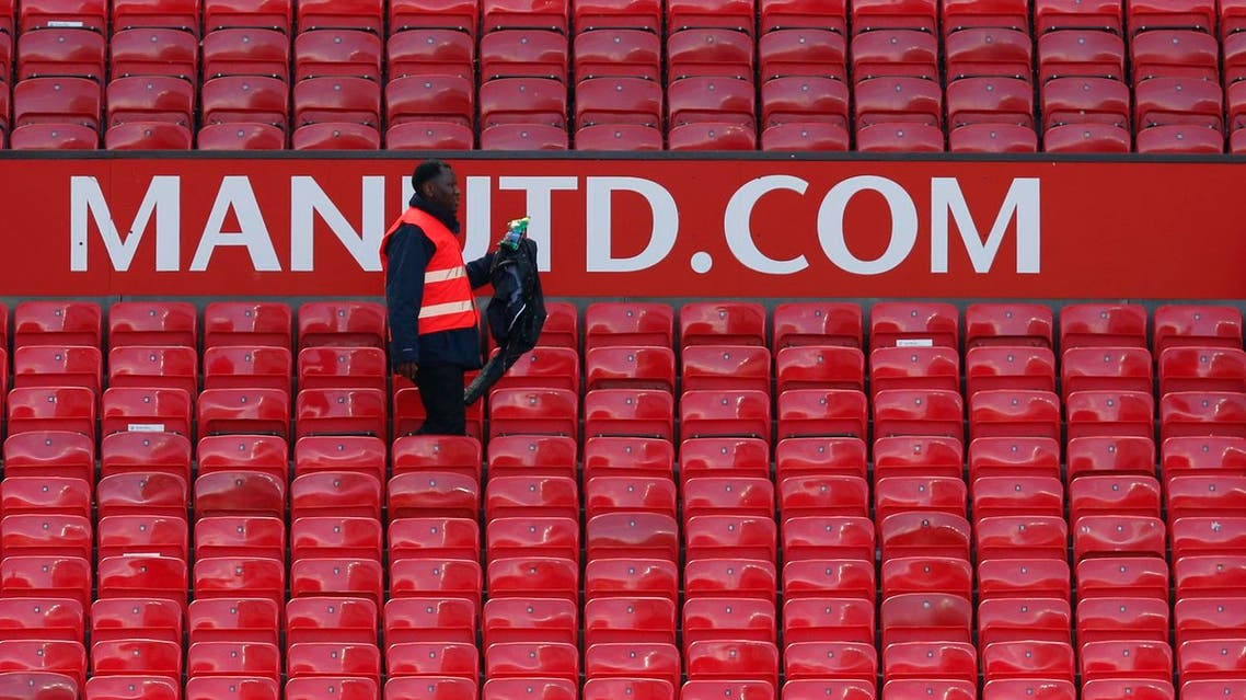"""Britain Soccer Football - Manchester United v AFC Bournemouth - Barclays Premier League - Old Trafford - 15/5/16 A steward as the match is abandoned Reuters / Andrew Yates Livepic EDITORIAL USE ONLY. No use with unauthorized audio, video, data, fixture lists, club/league logos or """"live"""" services. Online in-match use limited to 45 images, no video emulation. No use in betting, games or single club/league/player publications. Please contact your account representative for further details."""