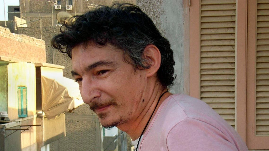 This June 2007 file photo shows Eric Lang, a French resident of Cairo, who died Sept. 13, 2013 while in police custody in the Egyptian capital, on the balcony of an apartment in the Sayeda Zeinab neighborhood of Cairo, Egypt. On Sunday, May 15, 2016 Egypt's official MENA news agency said a Cairo court has convicted six men of manslaughter and sentenced them to seven years in prison for beating Lang to death while in police custody in 2013. (AP)