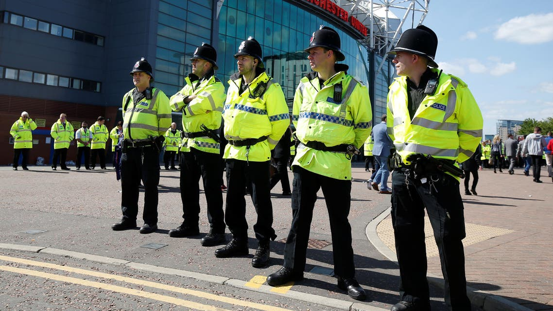 General view of police outside the stadium after the match was abandoned. (Reuters)