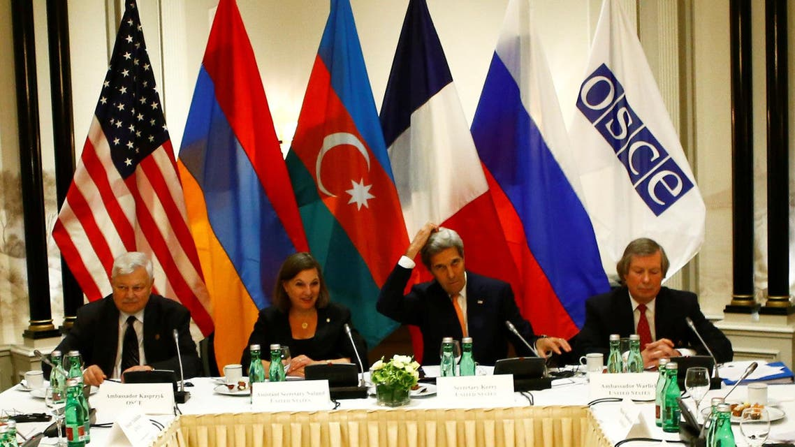 Russian Foreign Minister Sergei Lavrov, left, Armenia's President Serzh Sargsyan, second left, U.S. Secretary of State John Kerry, center, and President Ilham Aliyev of Azerbaijan, right, attended the meeting in Vienna. (AP)