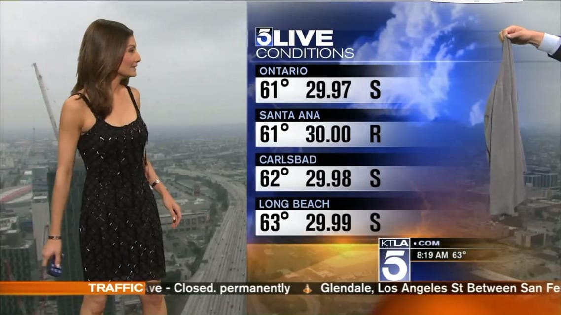 KTLA-TV weather anchor Liberte Chan's co-host handed her a dull-looking, gray sweater. (Screenshot)