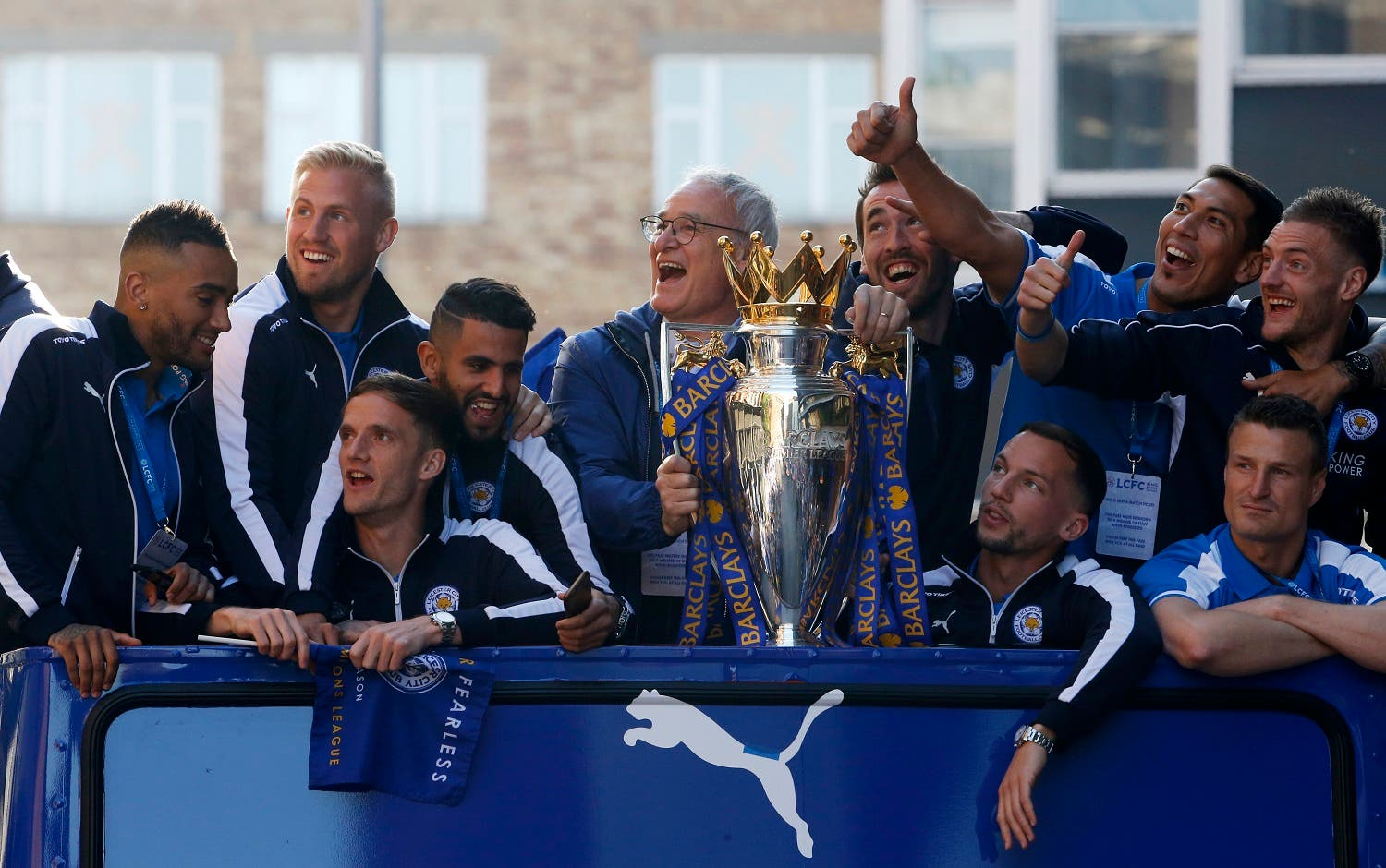 Leicester City manager Claudio Ranieri, Danny Simpson, Kasper Schmeichel, Riyad Mahrez, Andy King, Christian Fuchs, Danny Drinkwater, Leonardo Ulloa, Robert Huth and Jamie Vardy with the trophy on the bus during the parade. (Reuters)