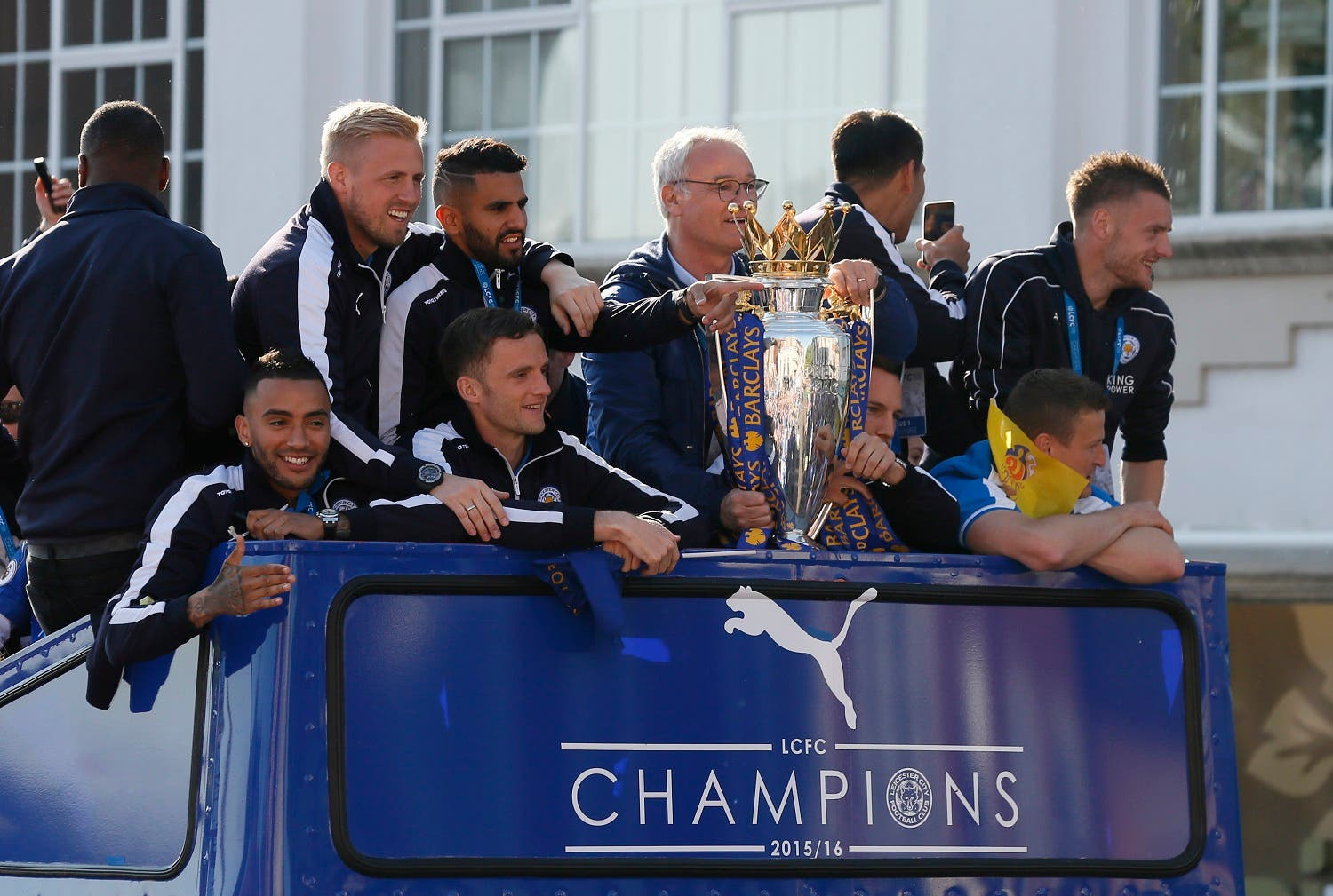 Leicester City manager Claudio Ranieri, Kasper Schmeichel, Riyad Mahrez, Andy King, Danny Simpson, Danny Drinkwater, Jamie Vardy and Robert Huth celebrate with Premier League trophy during the parade. (Action Images via Reuters)