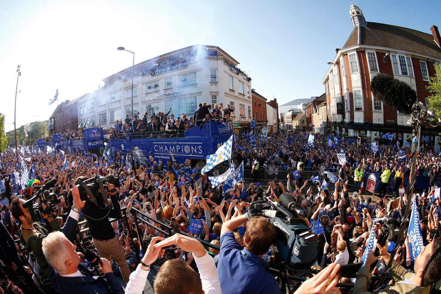 Leicester City celebrate with Premier League trophy and fans during the parade Action Images via Reuters