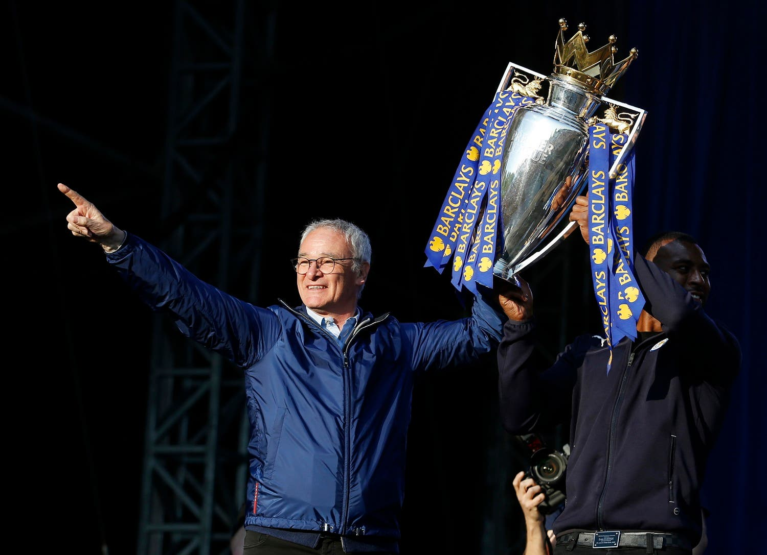 Leicester City manager Claudio Ranieri and Wes Morgan on the stage with the trophy during the parade. (Action Images via Reuters)
