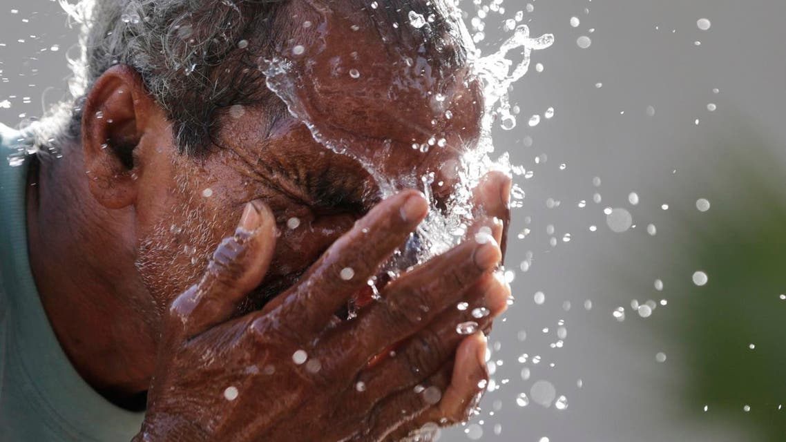 An Indian man splashes water on his face as he tries to cool himself on a hot summer afternoon in Lucknow, India, Monday, May 16, 2016. Much of India has been suffering from a heat wave for weeks along with a severe drought that has decimated crops, killed livestock and left at least 330 million Indians without enough water for their daily needs. (AP)