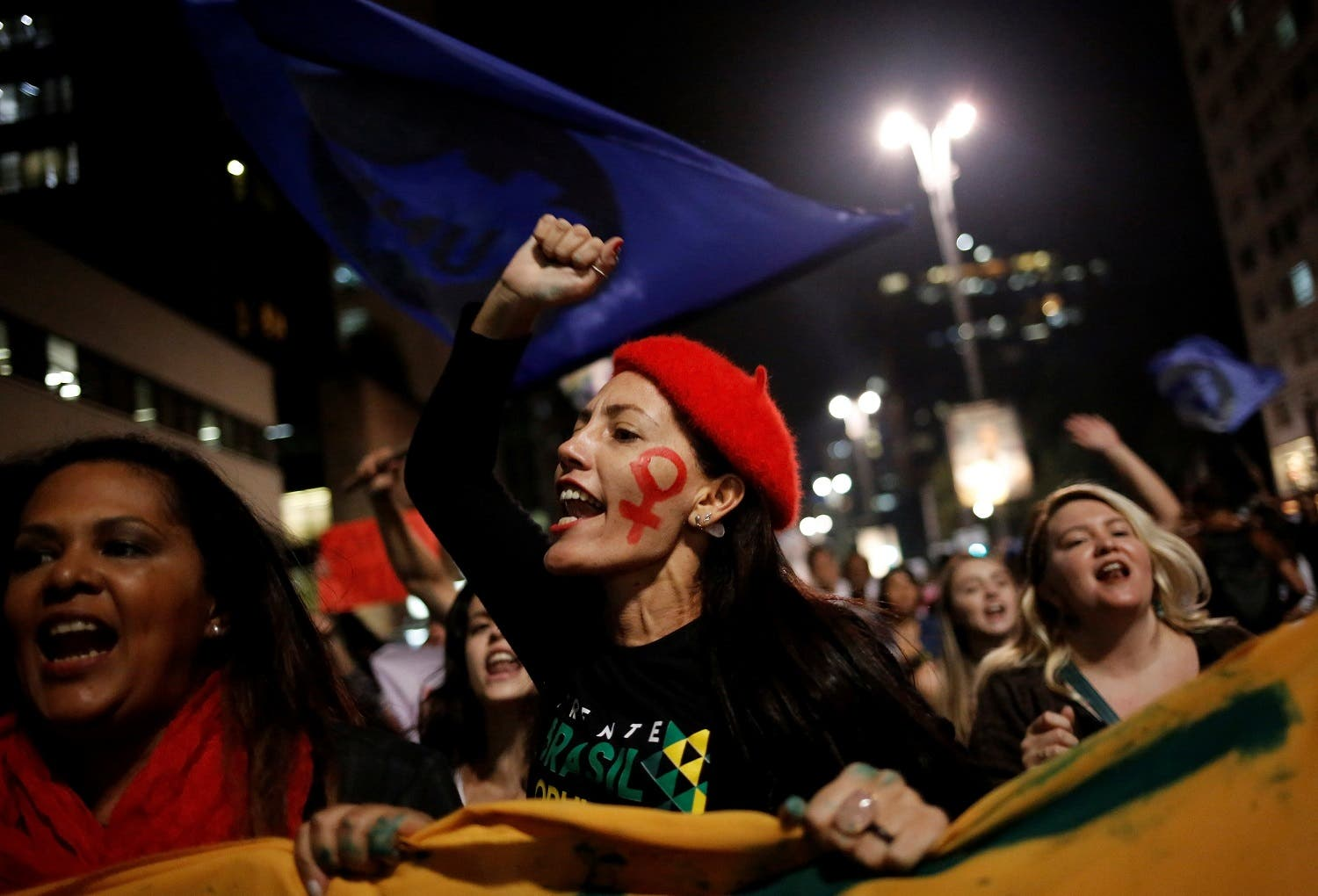 Women shout slogans during a protest against Brazil's interim President Michel Temer and in support of suspended President Dilma Rousseff at Paulista Avenue in Sao Paulo. (Reuters)