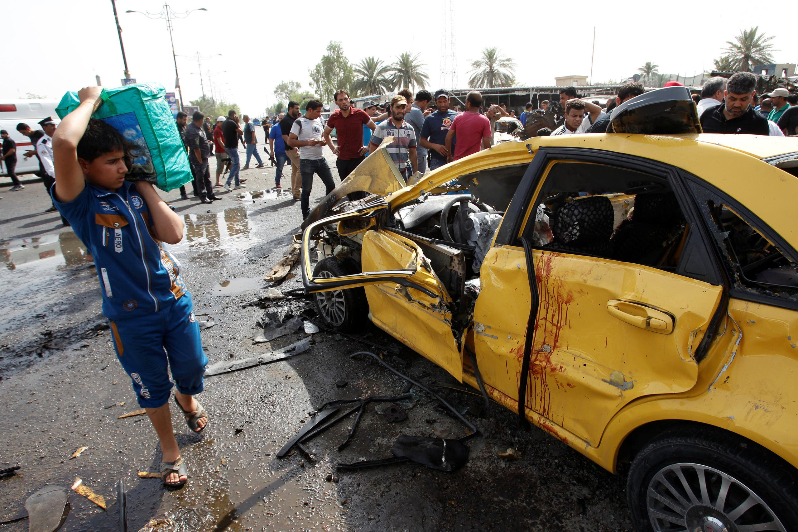 Aftermath of three bomb attacks in Baghdad
