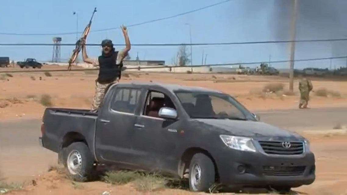 Forces loyal to Libyan unity government celebrate the recapture Abu Grain, one of the main checkpoints south of the city of Misrata. (Reuters)