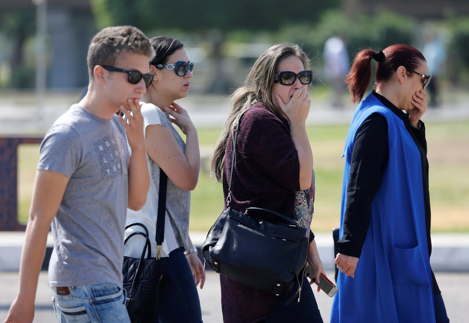 Unidentified relatives and friends of passengers who were flying in an EgyptAir plane wait outside the Egyptair in-flight service building in Cairo. (Reuters)