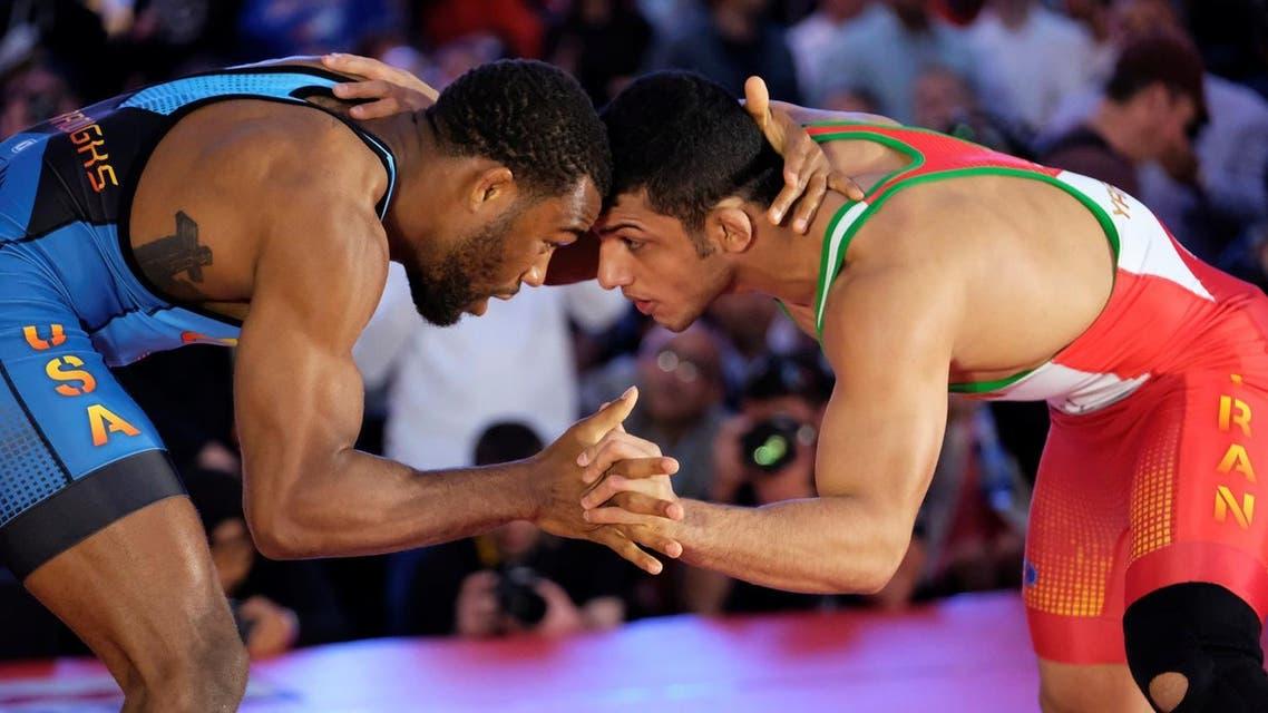 Olympic champion Jordan Burroughs grappled with Iran's Asian champion Peyman Yarahmadi in the 74kg freestyle. (Reuters)
