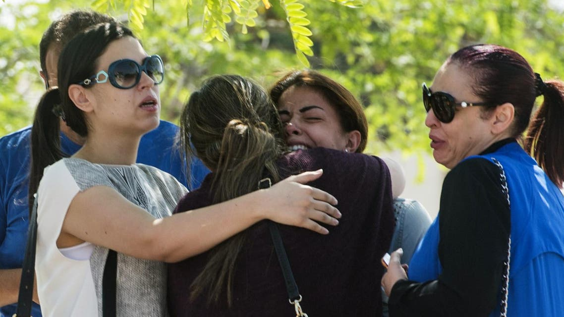 Families of passengers who were flying on board an EgyptAir plane that vanished from radar en route from Paris to Cairo react as they wait outside a services hall at Cairo international airport on May 19, 2016. (AFP)