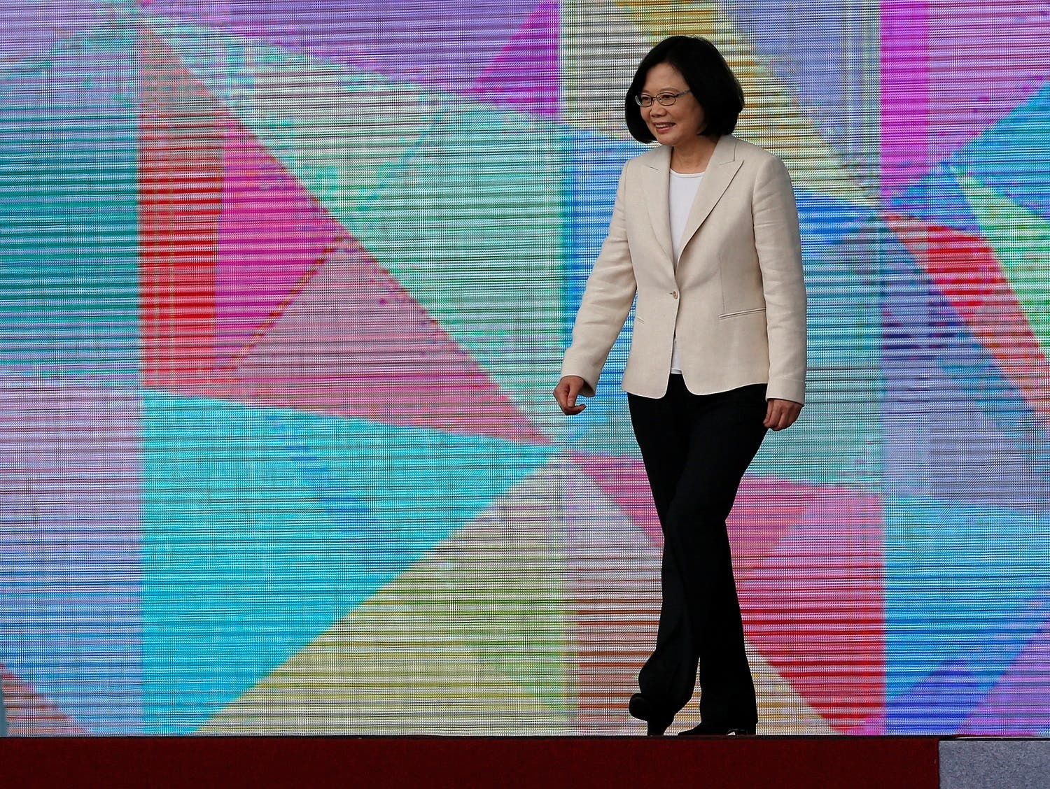 Taiwan's President Tsai Ing-wen walks on the podium before addressing during an inauguration ceremony in Taipei. (Reuters)
