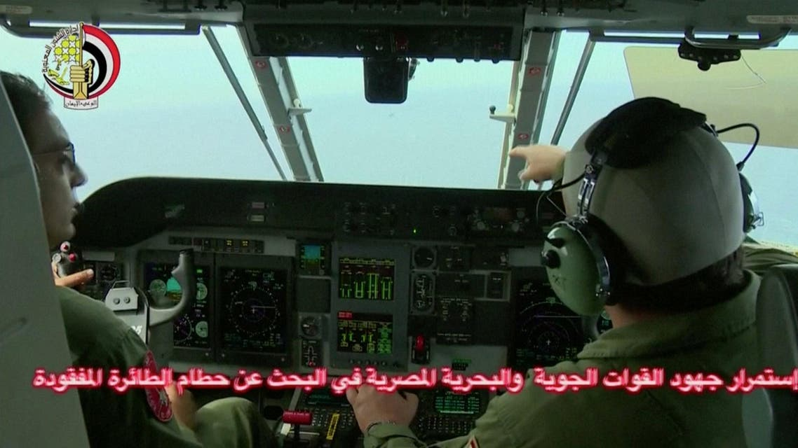 An Egyptian pilot (R) points during a search operation by Egyptian air and navy forces for the EgyptAir plane that disappeared in the Mediterranean Sea, in this still image taken from video May 20, 2016. (Reuters)
