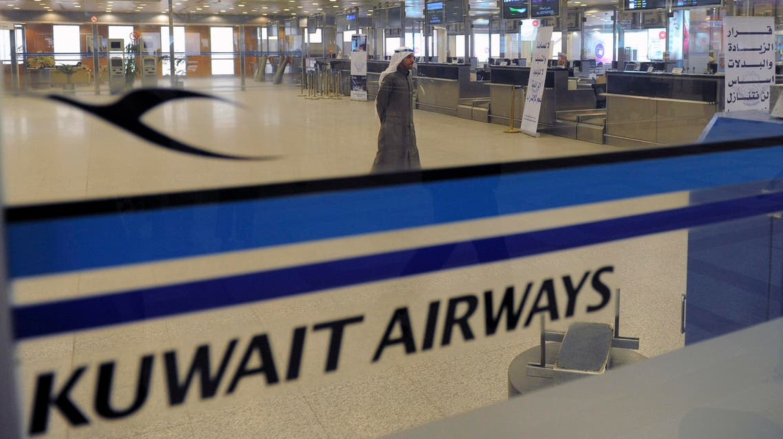 View of empty Kuwait Airways check-in counters at Kuwait Airport on Sunday, March 18, 2012. AP