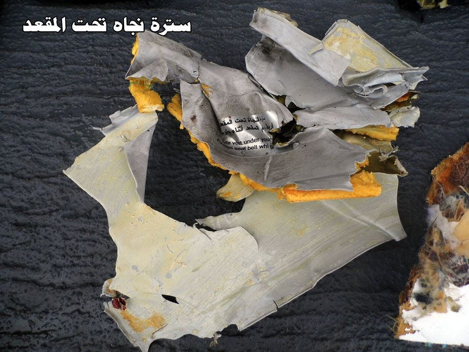 Image shows a life jacket under a passenger seat belonging to the crashed EgyptAir jet. (Photo courtesy: Egyptian armed forces)