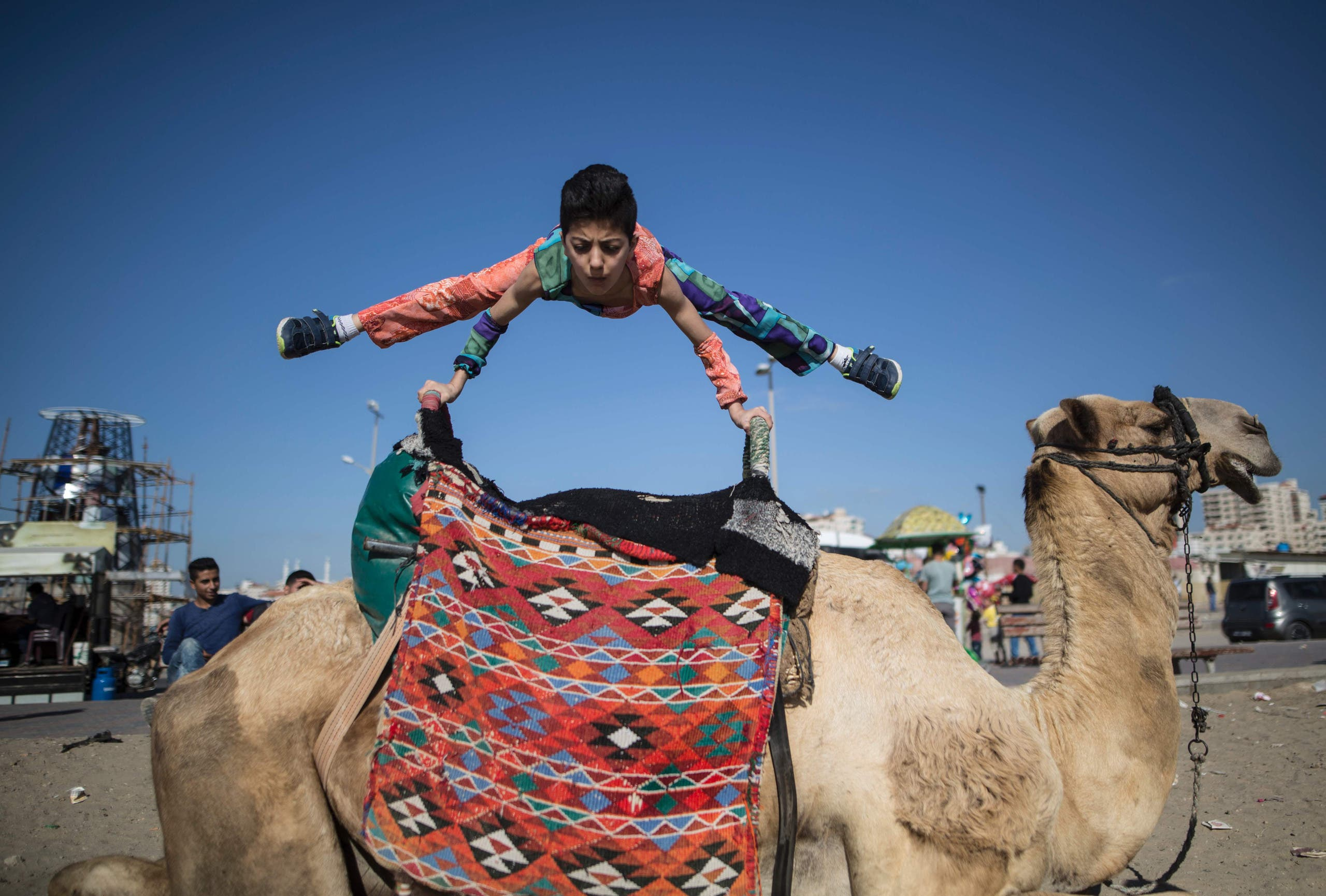 Mohammed, just 1.37 metres tall and weighing 29 kilograms, can bend his body in seemingly impossible ways. (AFP)