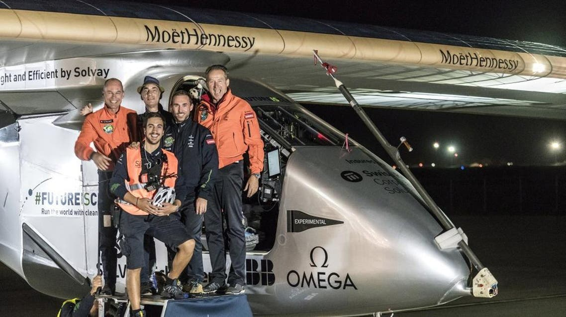 Swiss pilot Bertrand Piccard (L) and alternate pilot Andre Boschberg (R), also of Switzerland, pose with crew members in front of Solar Impulse 2 (Si2), the solar-powered plane, after landing at Tulsa International Airport, Oklahoma, U.S. May 12, 2016 Reuters