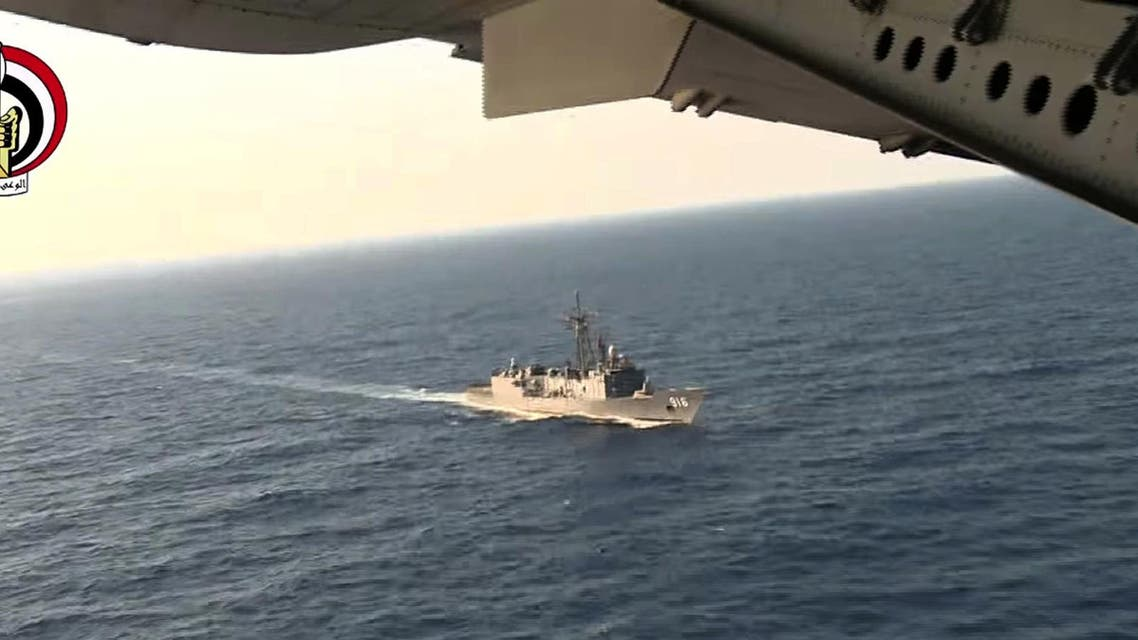 In this Thursday, May 19, 2016 video image released by the Egyptian Defense Ministry, an Egyptian plane flies over an Egyptian ship during the search in the Mediterranean Sea for the missing EgyptAir flight 804 plane. (AP)