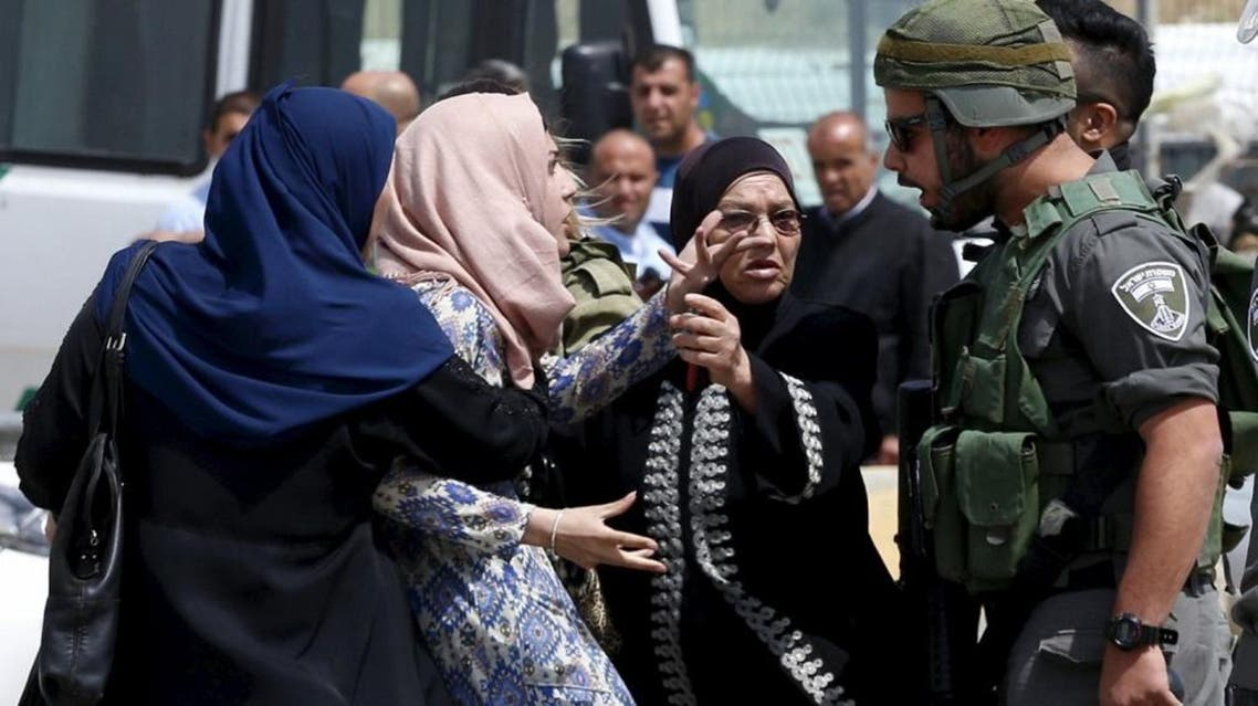 A Palestinian woman argues with an Israeli border policeman near the scene where two Palestinians who the Israeli military said tried to stab security forces were shot dead by Israeli police near Qalandia checkpoint near the West Bank city of Ramallah April 27 REUTERS
